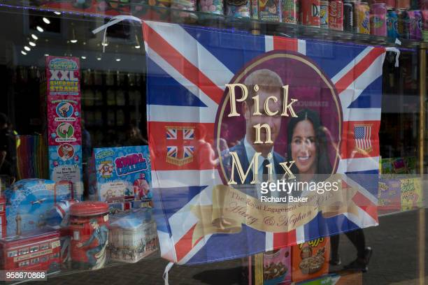 The faces of Prince Harry and Meghan Markle in a confectionary shop window as the royal town of Windsor gets ready for the royal wedding between the...