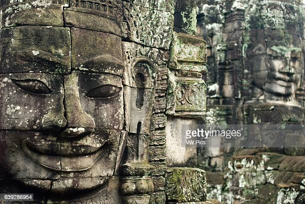 The faces of the Bayon temple Angkor Thom Angkor Thom was built as a square the sides of which run exactly north to south and east to west Standing...