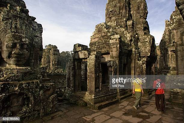 The faces of the Bayon temple Angkor Thom The Bayon was built nearly 100 years after Angkor Wat The basic structure and earliest part of the temple...