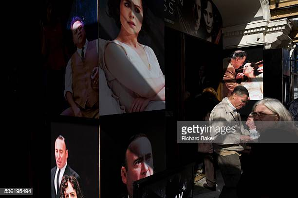 The faces of theatre-goers mix with the actors at the entrance of the Vaudeville in London's Strand where Arthur Miller's Broken Glass is playing....