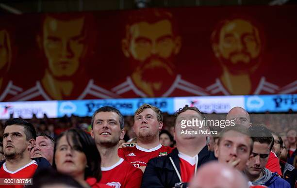 The faces of Wales footballers Gareth Bale Joe Ledley and Joe Allen on boards over the supporters during the 2018 FIFA World Cup Qualifier between...