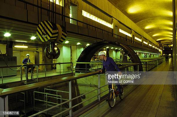 The factory 30 years of 'La Rance' tidal power station In Saint Malo France On July 23 1996 Inside the dam getting around on bikes