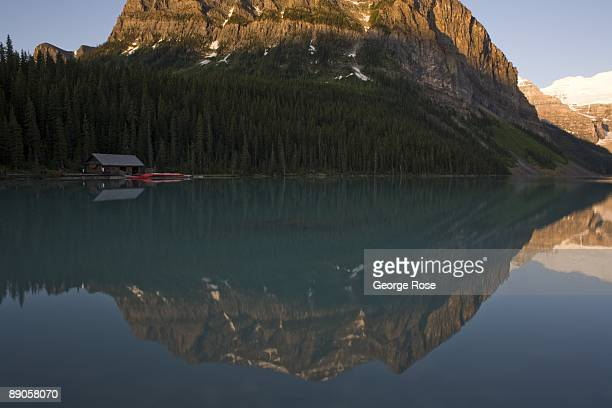 The Fairmont Chateau Lake Louise Hotel canoe boathouse and Fairview Mountain is seen in this 2009 Lake Louise Canada summer morning reflection...