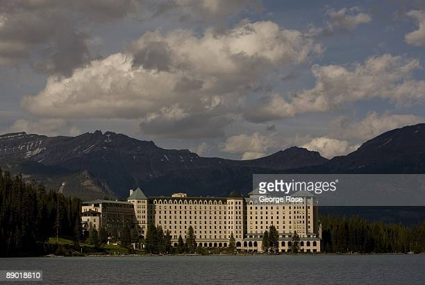 The Fairmont Chateau Lake Louise Hotel is seen from a distance across the lake in this 2009 Lake Louise Canada summer late afternoon landscape photo