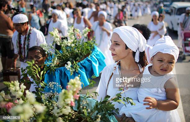 The faithful gather for a ceremony honoring Iemanja, Goddess of the Sea, as part of traditional New Year's celebrations on the sands of Copacabana...