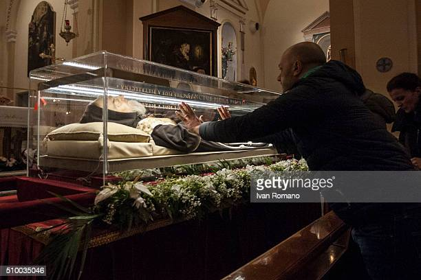 The faithful pay homage to the remains of St Pio The mortal remains of Saint Pio one of the most popular Roman Catholic saints and better known as...