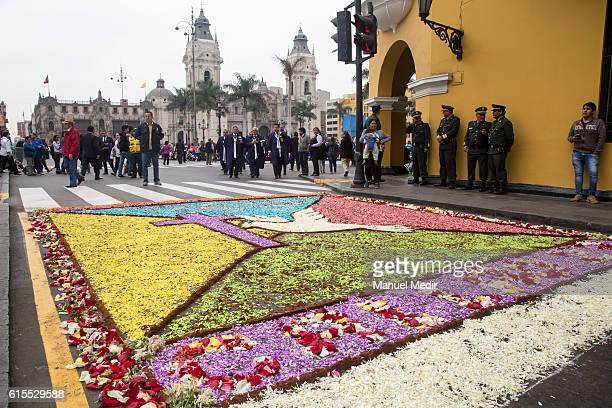 The faithfull of the 'Lord of Miracles' made flower carpets during a procession honoring Peru's most revered Catholic religious icon the 'Lord of...