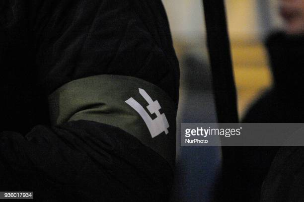 The falanga symbol belonging to the farright Polish youth organization National Radical Camp is seen on an armband during a right wing demonstration...