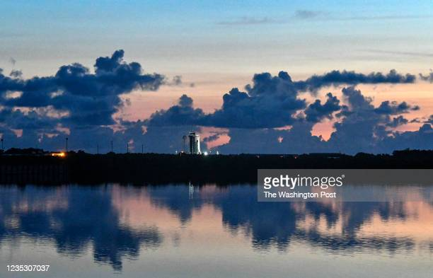The Falcon 9 rocket with the Crew Dragon capsule at sunrise on launch day. The SpaceX launch of the Inspiration4 crew manned by civilian astronauts,...