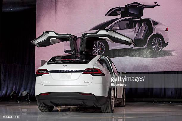 The 'falconwing' doors of the Tesla Motors Inc Model X sport utility vehicle are presented during an event in Fremont California US on Tuesday Sept...