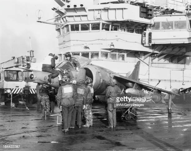 The Falklands Conflict April June 1982 A Hawker Siddeley Harrier GR3 of No 1 Squadron RAF is prepared for a sortie on board HMS HERMES Attached to...