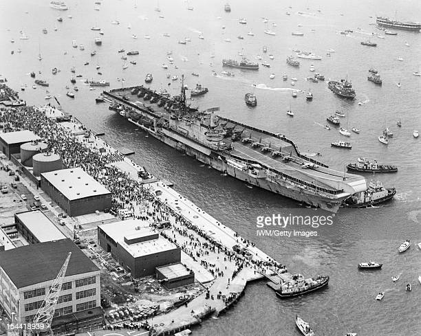 The Falklands Conflict April June 1982 Aerial view of the aircraft carrier HMS HERMES about to berth alongside at Portsmouth Harbour on her return...