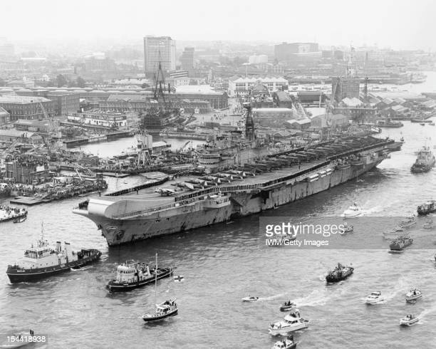 The Falklands Conflict April June 1982 HMS HERMES passes HMS VICTORY as she enters Portsmouth harbour on returning from the Falklands on 21 July 1982