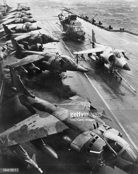 The Falklands Conflict April June 1982 Three Hawker Siddeley Harrier GR3s of No 1 Squadron RAF ranged alongside seven Royal Navy British Aerospace...