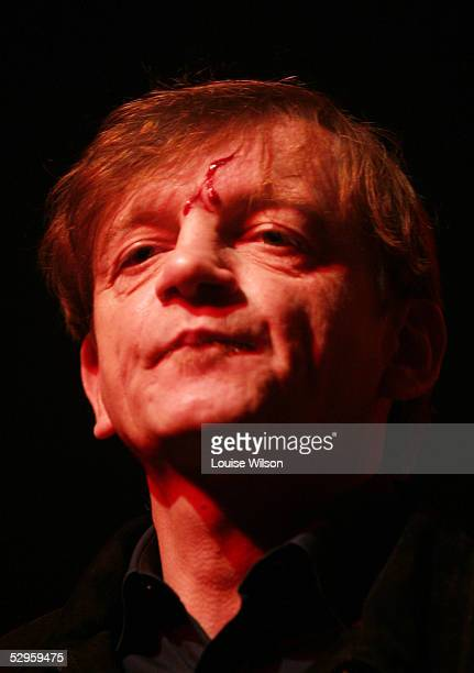 The Fall frontman Mark E Smith sporting a gash on his forehead from debris thrown by fans stands onstage during a performance promoting the sixdisc...