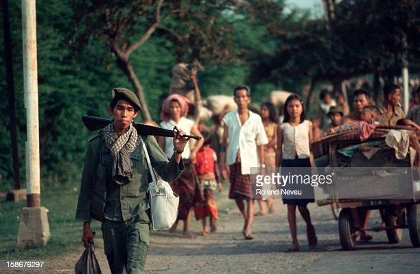 The fall of Phnom Penh to the Khmer Rouge. After the evacuation of Americans, thousands of civilians flee the fighting in the suburbs of Phnom Penh...