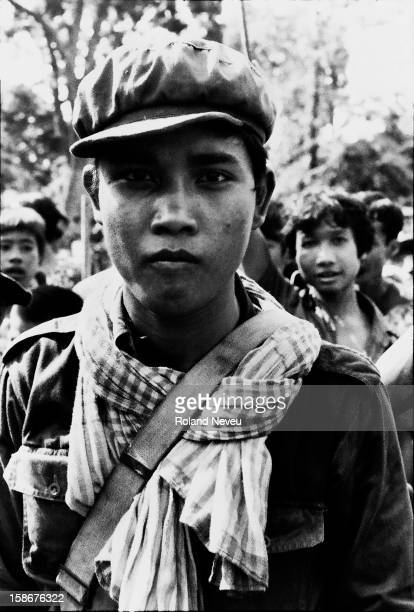 The Fall of Phnom Penh to the Khmer Rouge on April 17 1975 A young khmer guerrilla wearing a Mao style cap and a Cambodia krama is looking straight...