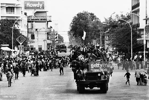 The Fall of Phnom Penh to the Khmer Rouge on April 17 1975 Amid cheering from some groups of people on the Monivong avenue a convoy is form with the...