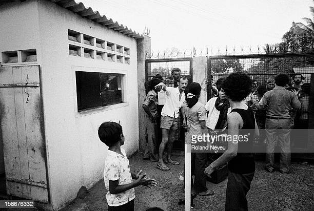 The Fall of Phnom Penh to the Khmer Rouge on April 17 1975 At the gate at the French Embassy consular authorities are trying to accommodate the flux...