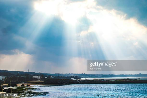 the falling sun - sustainable development goals stock pictures, royalty-free photos & images