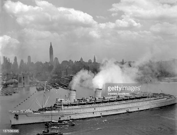 The famed British liner RMS Queen Mary arrives in New York Harbor carrying thousands of American troops home from Europe June 1945 US Navy photo