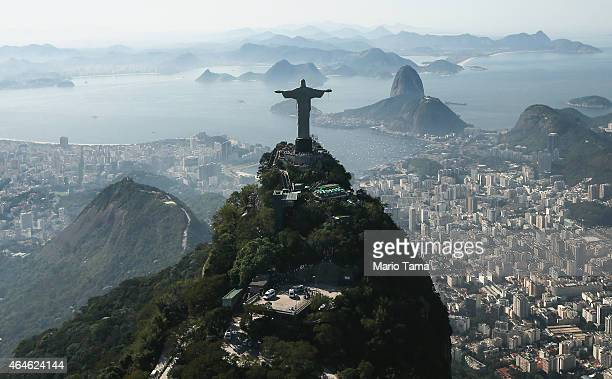 The famed Christ the Redeemer statue stands atop Corcovado mountain in an aerial view on June 27 2014 in Rio de Janeiro Brazil The Art Deco statue is...