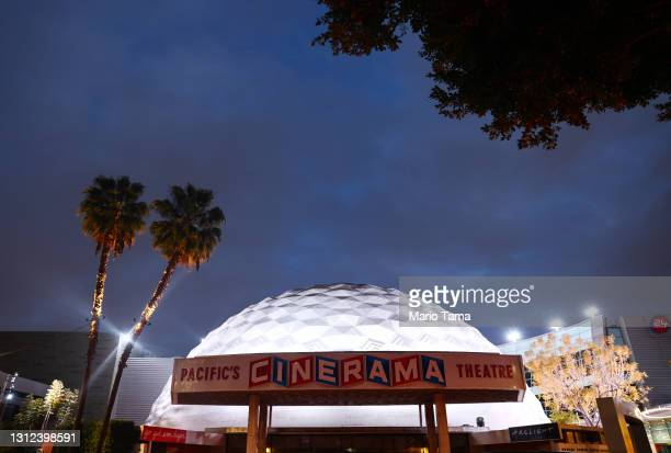 The famed Cinerama Dome is lit at dusk at the shuttered ArcLight Hollywood movie theater on April 13, 2021 in Los Angeles, California. Decurion, the...