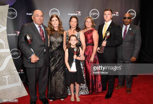 The families and fellow coach of Marjory Stoneman Douglas High School coaches Aaron Feis Scott Beigel and Chris Hixon winners of Coach of the Year...