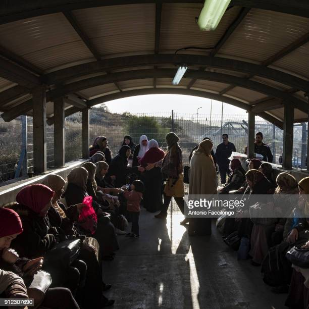 The families of Palestinian prisoners await at a checkpoint that their documents and special permits will be checked by Israeli soldiers on the day...
