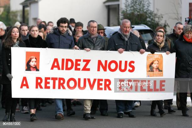 The familly of Estelle Mouzin including Eric Mouzin the father hold a banner reading help us find Estelle during a silent march in Guermantes near...