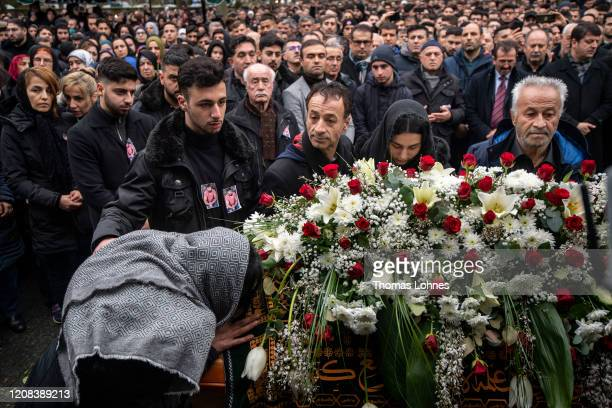 The family and friends pray during the funeral of Ferhat Unvar, one of the victims of last week's mass shooting on February 24, 2020 in Hanau,...