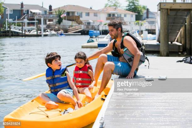The family, father and two kids, getting ready to go kayaking