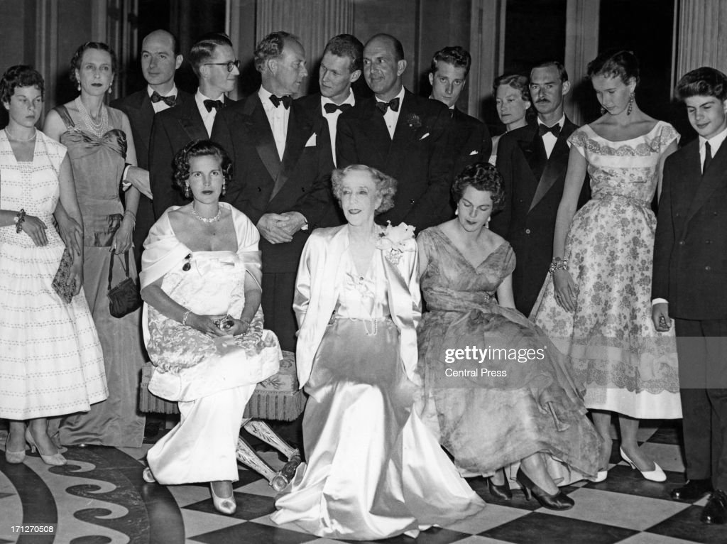 The family has gathered to celebrate the 80th birthday of Queen Elisabeth of Belgium (centre) at the Royal Castle of Laeken. Seated L - R are Princess Lilian of Belgium (1916 - 2002), Queen Elisabeth of Belgium (1876 - 1965), Princess Maria Pia of Savoy. Standing behind L - R are Princess Maria Beatrice of Savoy, Ex-Queen Marie Jose of Italy (1906 - 2001), Prince Alexander of Yugoslavia, King Baudouin of Belgium (1930 - 1993), Ex-King Leopold III of Belgium (1901 - 1983), Vittorio Emanuele, Prince of Naples, Ex-King Umberto II of Italy (1904 - 1983), Prince Albert of Belgium, later King Albert II of Belgium, Princess Josephine Charlotte of Belgium (1927 - 2005), Grand Duke Jean of Luxembourg, Princess Maria Gabriella of Savoy, and Prince Alexander of Belgium (1942 - 2009), Brussels, 25th July 1956.