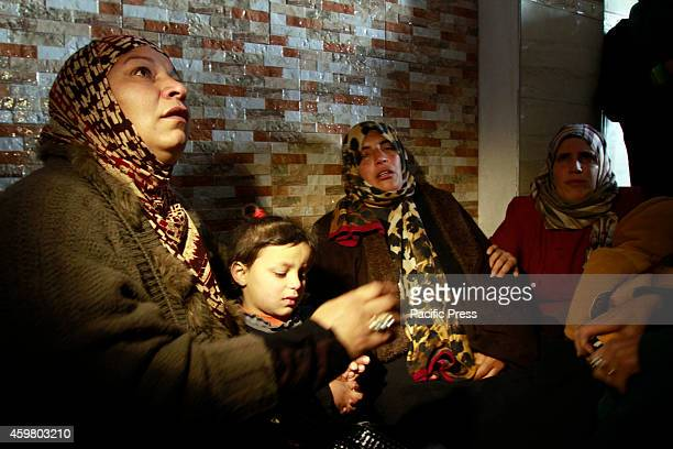 The family of Amal Jihad Taqatqa a Palestinian woman from Beit Fajjar near the West Bank city of Bethlehem cry in their home after Amal was allegedly...