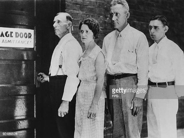 The family of American bank robber John Dillinger wait outside a theatre in Indianapolis where they will be regaling the audience with tales of the...