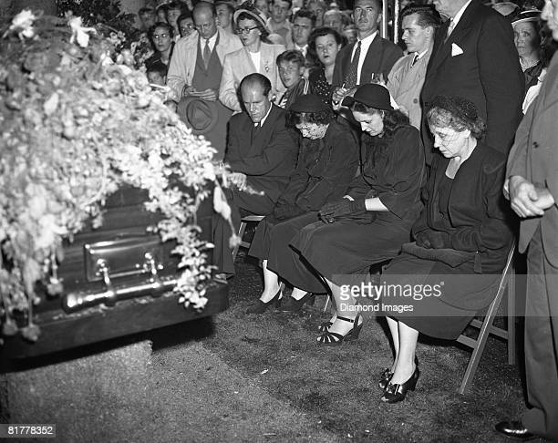 The family of Babe Ruth sits next to his casket as the last rites are given on August 19 1948 at Gate of Heaven Cemetary in Hawthorne New York Those...