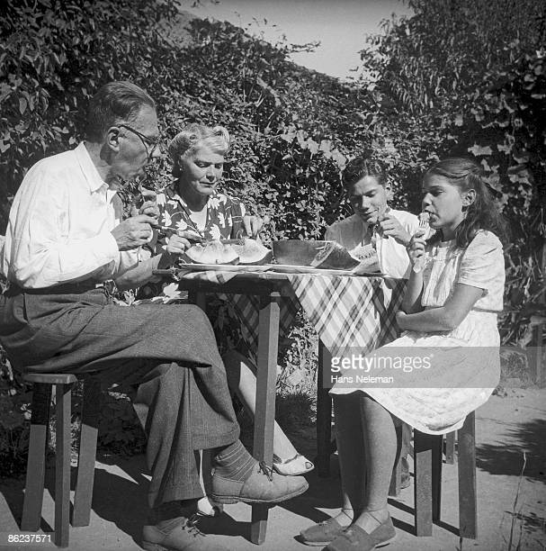 The family of Chilean painter Laureano Guevara share a watermelon at an outdoor table in theor garden on Echenique Avenue, La Reina, Santiago Region,...