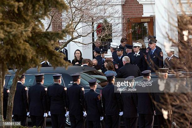 The family of Daniel Barden a victim of the shooting at Sandy Hook Elementary School, arrive at St. Rose of Lima Church for his funeral December 19,...