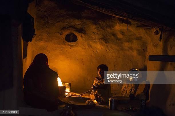 The family of Dhanu Sahariya sit next to a fire at his home in the village of Sakara in Lalitpur district Madhya Pradesh India on Saturday Feb 9 2016...