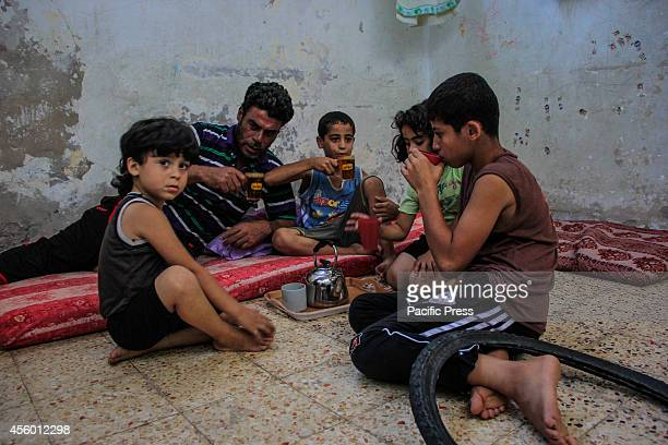 The family of Imad Jouda 42 years of age father of five children living in the Shati refugee camp on the shore of the Sea of Gaza Imad a construction...