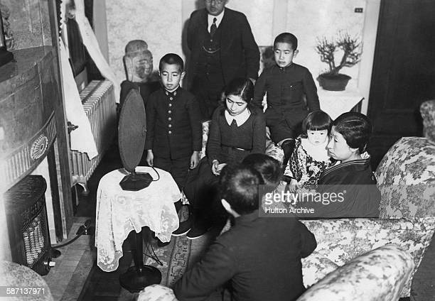 The family of Japanese diplomat Yosuke Matsuoka the Japanese envoy to the League of Nations Assembly in Geneva Switzerland listening to his speech...