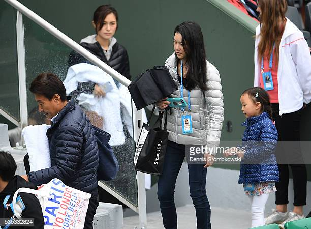 The family of Kei Nishikori of Japan attend his Mens Singles fourth round match against Richard Gasquet of France on day eight of the 2016 French...