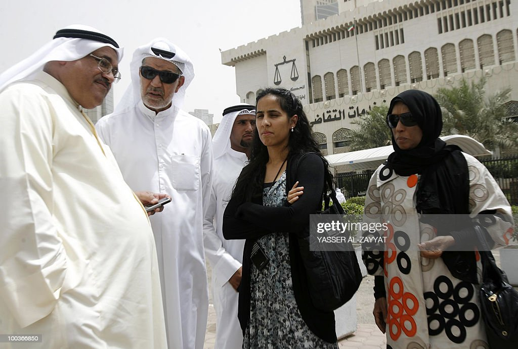 The family of Kuwaiti writer Mohammad Abdulqader al-Jassem, including his daughter Sumayya (2nd R), his son Ahmad (C), and his wife Umm Omar (R) stand outside the court in Kuwait city, along with other supporters, including fellow writer Ahmad al-Dayeen (L), during his trial on May 24, 2010. The top Kuwaiti writer and government critic was officially charged with harming national interests and undermining the status of the Gulf state's ruler. Jassem, also a journalist and lawyer, categorically denied the charges, insisting that his trial is purely political.