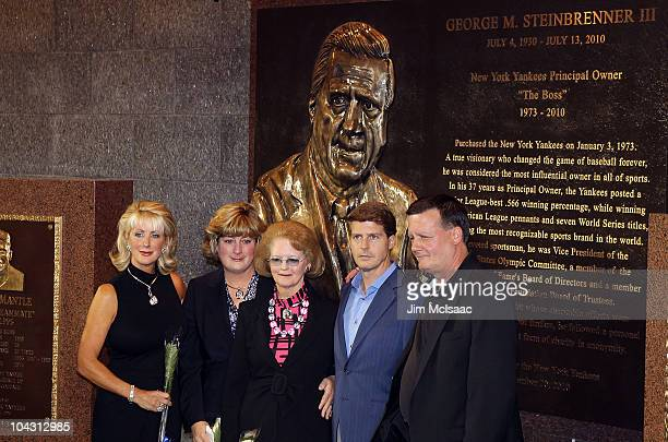The family of late New York Yankees owner George Steinbrenner poses in front of the newly unveiled monument prior to game against the Tampa Bay Rays...