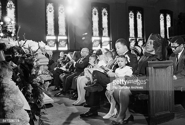 The family of Martin Luther King Jr sits in the front pew during his funeral at Ebenezer Baptist Church