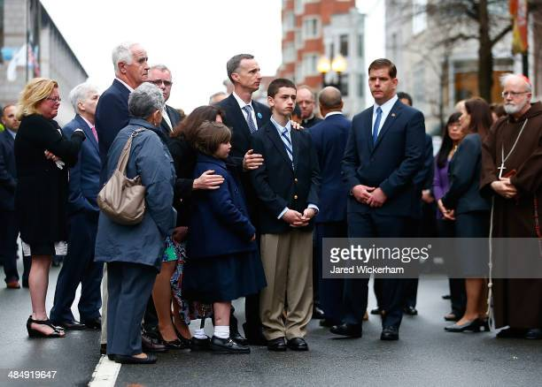 The family of Martin Richard including Bill Richard along with Boston mayor Marty Walsh and other members of the victims families stand during a...