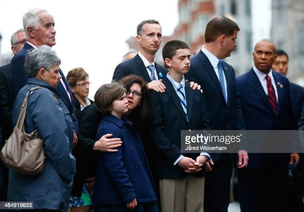 The family of Martin Richard including Bill Richard and other members of the victims families stand during a wreathlaying ceremony commemorating the...