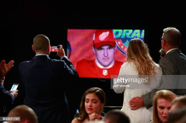 The family of Michael Rasmussen ninth overall pick of the Detroit Red Wings watches the tv screen during Round One of the 2017 NHL Draft at United...