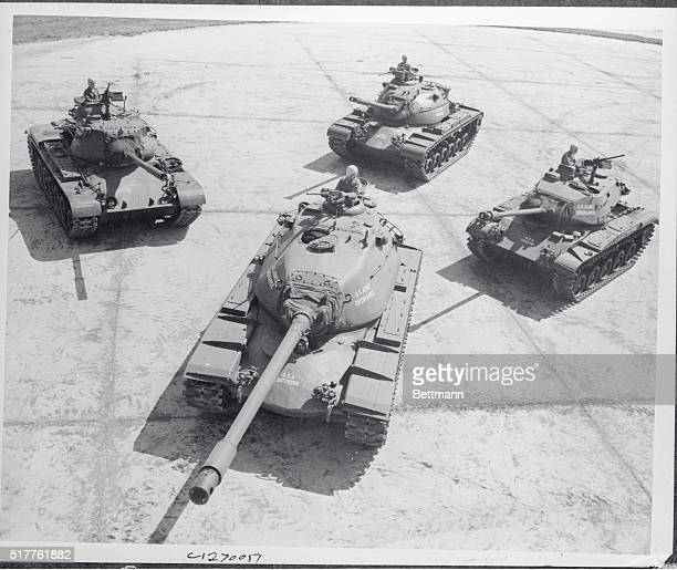 The 'Family' of modern PostWorld War II tanks are displayed by army ordinace personnel at Aberdeen proving ground Maryland In the foreground is the...