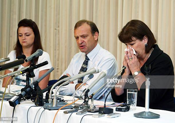The family of murdered teacher Lindsay Hawker including Bill Hawker, center, along with his wife Julia and daughter Louise, listen to questions...